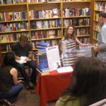 Josh Weil and Tess Callahan signing books at Newtonville Books